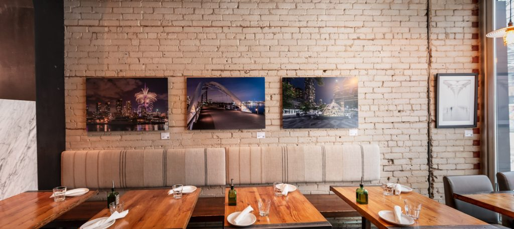 Jeff Shaw Photography artwork hanging at Pizzeria Defina in Toronto